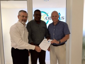 CEO Mark Topley with Malcolm and Nic of Songas after signing the MoU
